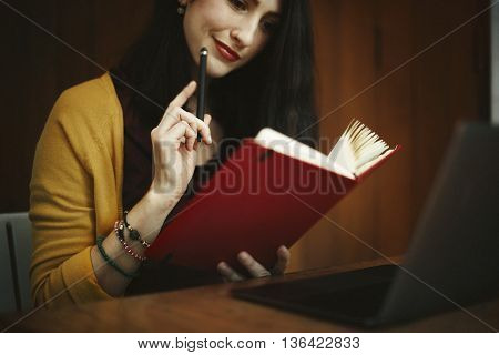 Woman Thinking Notebook Reading Ideas Concept
