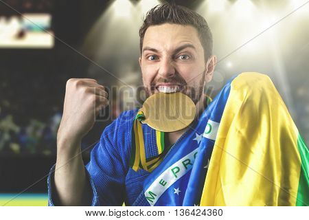 Brazilian fighter holding gold medal
