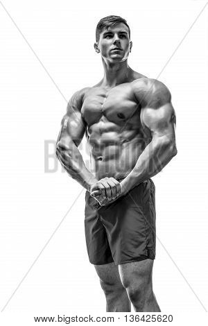 Strong Athletic Man showing muscular body and sixpack abs over white background. Black and white