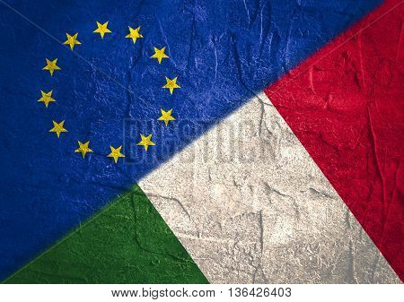 Image relative to politic relationships between European Union and Italy. National flags textured by concrete