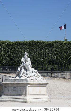 PARIS, FRANCE - JUNE 8, 2013:Sculptural composition in the Tuileries Garden in Paris on background French flag