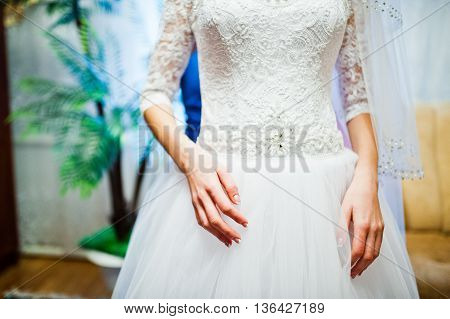 Hands of cute tender young bride at wedding