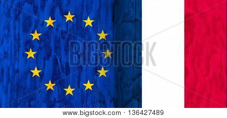 Image relative to politic relationships between European Union and France. National flags textured by wood