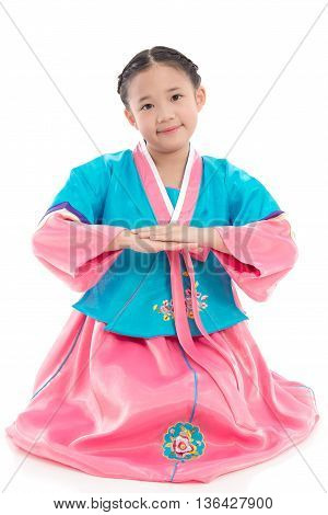 Asian girl in Korean Traditional Dress bowing on white background isolated