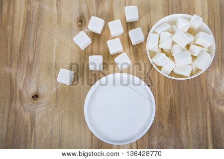 White sugar in a white bowls on the table