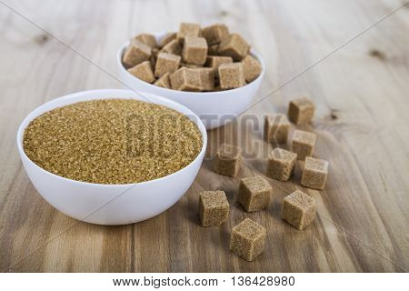 Cane sugar in a white bowls on the table