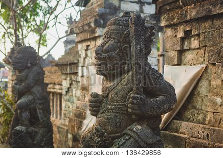 statue at the entrance to the temple, Bali, Indonesia