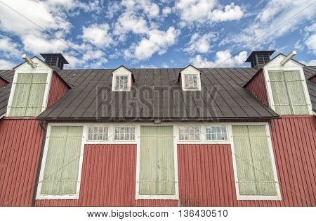 Old Stable Building with a partly cloudy sky.