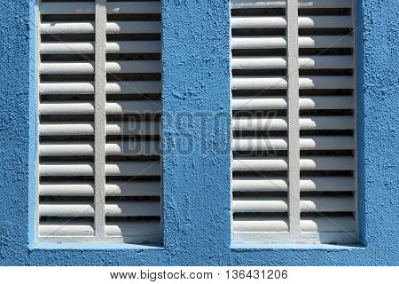 Detail of window with white sun shutter