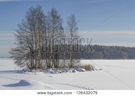 Little island in the middle wintry lake in Finland.