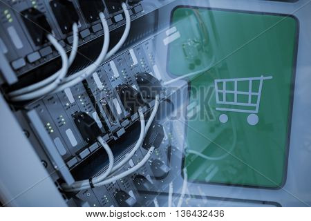 Green trolley button on keyboard against image of technology