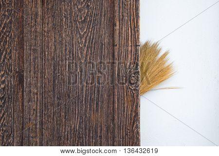 a broom behind wood on Plain background
