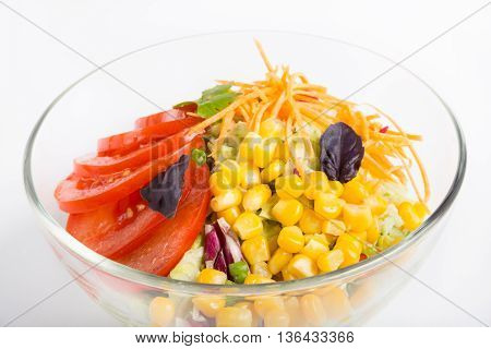 Mixed vegetables salad in a glass bowl