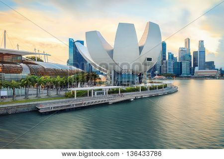 Singapore, Republic of Singapore - May 7, 2016: Panorama of Marina Bay with Artscience lotus flower museum at sunset.