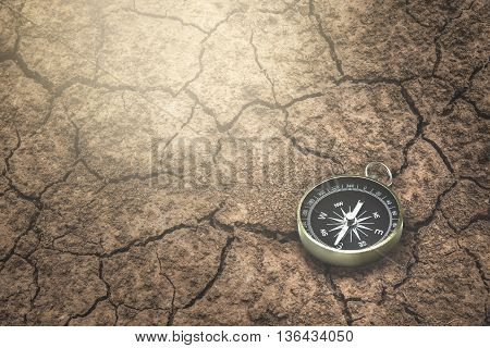 Compass on a the route dry cracked ground.