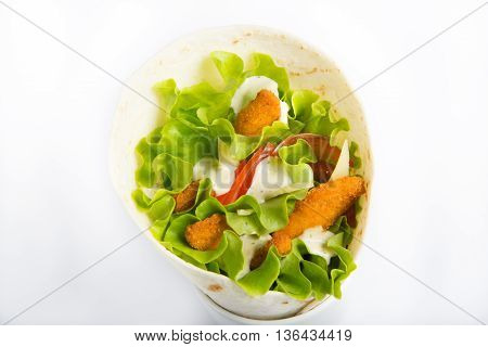 Chicken nuggets with vegetables roll on white background