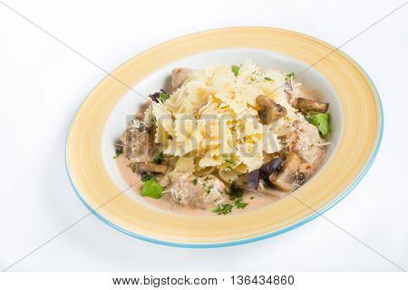 Pasta with cheese and mushrooms served on plate