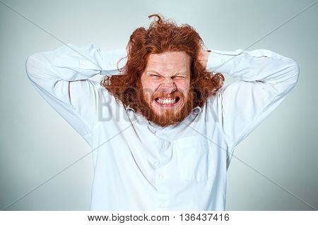 Stressed businessman with a headache. Hands of a man's head is compressed