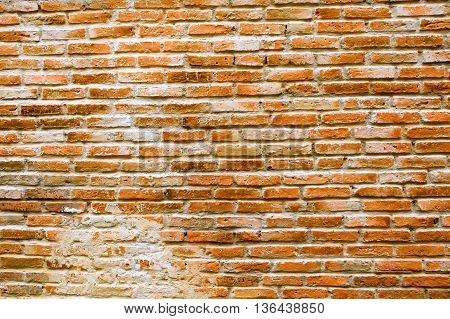 Red old vintage detailed brick aged wall for background