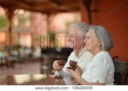 Nice senior couple with coffee on vacation