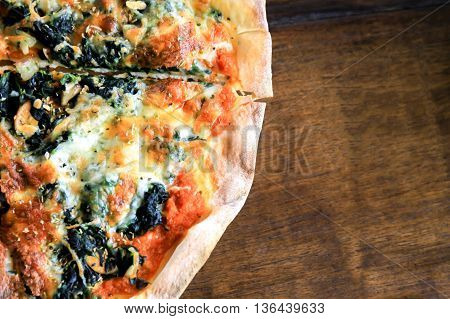 Slice Of Pizza Over Wooden Background With Copy Space