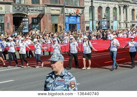 St. Petersburg, Russia - 9 May, People carrying the flag of victory, 9 May, 2016. Holiday-action