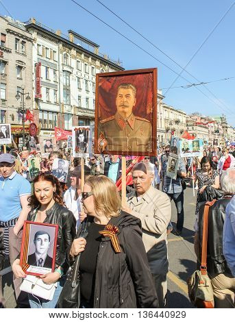 St. Petersburg, Russia - 9 May, A man with a portrait of Stalin, 9 May, 2016. Holiday-action
