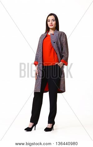 woman with straight hair style in casual woolen coat black trousers high heel shoes going full body length isolated on white