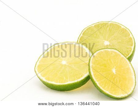Three slices of lime on white background bottom right corner