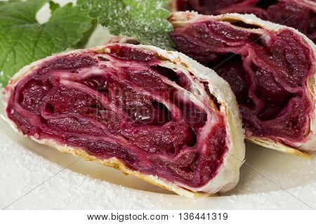 the cherry strudel on a white plate