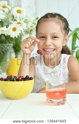 Portrait of cute Little girl  eating cherries