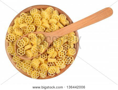 Uncooked Italian Pasta Rotelle In A Wooden Bowl On A White