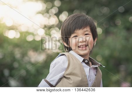 Close up portrait of asian boy laughing