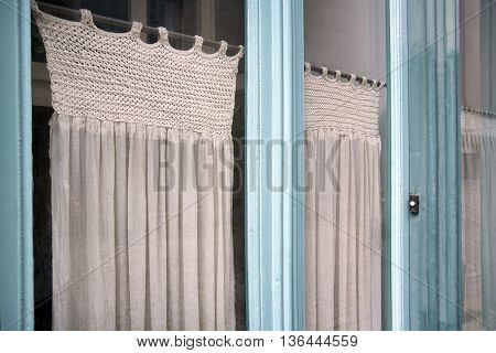 Nostalgia glass front door and partly knitted curtains