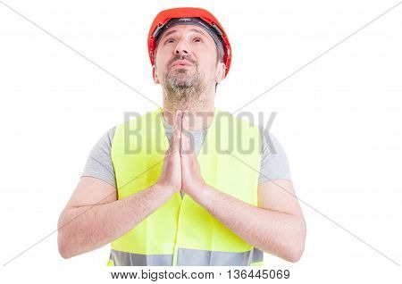 Professional Young Constructor Praying For A Miracle