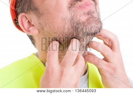 Closeup Of Male Builder Scratching His Beard