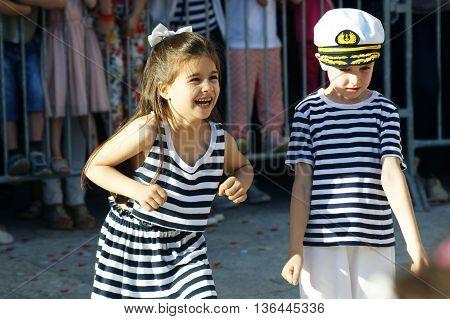 Montenegro, Herceg Novi - 04/06/2016: Girl and boy in carnival costume sailors. 10 International Children's Carnival in Herceg Novi