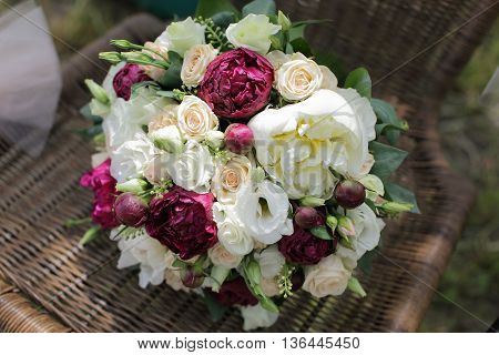 Wedding bouquet of white and pink roses and peonies