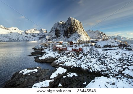 Red fishing hut (rorbu) on the Hamnoy island in winter Reine Lofoten Islands North Norway