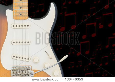 Electric guitar having red notes on a black background.