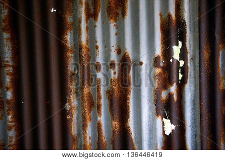 old rusty zinc plat wall at outdoor