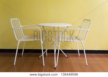 White Metal Chair And Desk Beside Wall