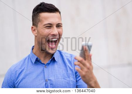 Man shouting at mobile phone