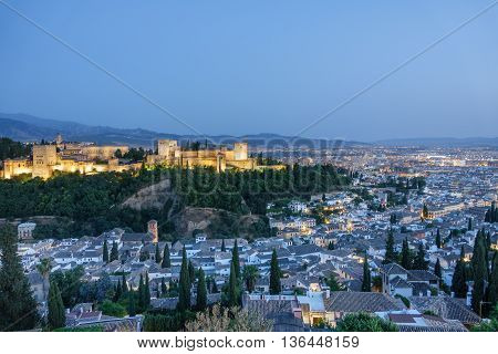 Wide angle view of Granada and the ancient arabic fortress of Alhambra at sunset. Spain.