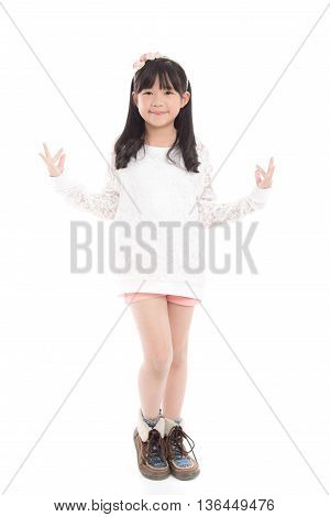 Beautiful asian girl dancing on white background isolated