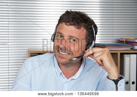 Customer service representative wearing a grey headset
