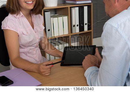 Investment Adviser Giving Presentation Smiling Man Seated Desk In Office