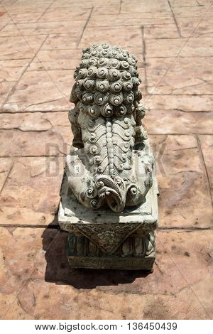 A lion statue symbolizes to the protector in front of the entry way.