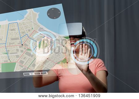 technology, virtual reality, cyberspace, entertainment and people concept - happy young woman with virtual reality headset or 3d glasses at home looking at gps navigator map projection