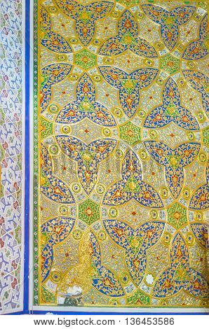 BUKHARA UZBEKISTAN - APRIL 29 2015: The wall of the Museum of Costume of Sitorai Mokhi-Khosa Complex decorated with the golden trefoil pattern on April 29 in Bukhara.